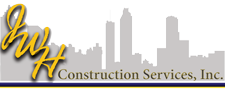 JWH construction logo with a skyline in the background and cursive JWH lettering